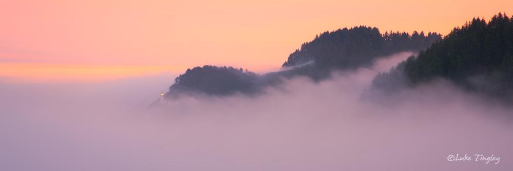 Coastal fog engulfs Heceta Head lighthouse along the southern Oregon coast.