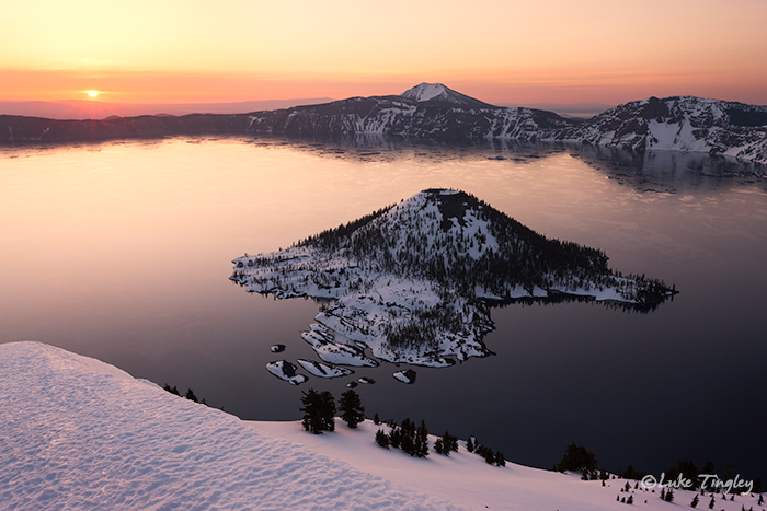 Sunrise on a beautiful morning at Crater Lake National Park. We snow shoed in the day before and camped near the top of...