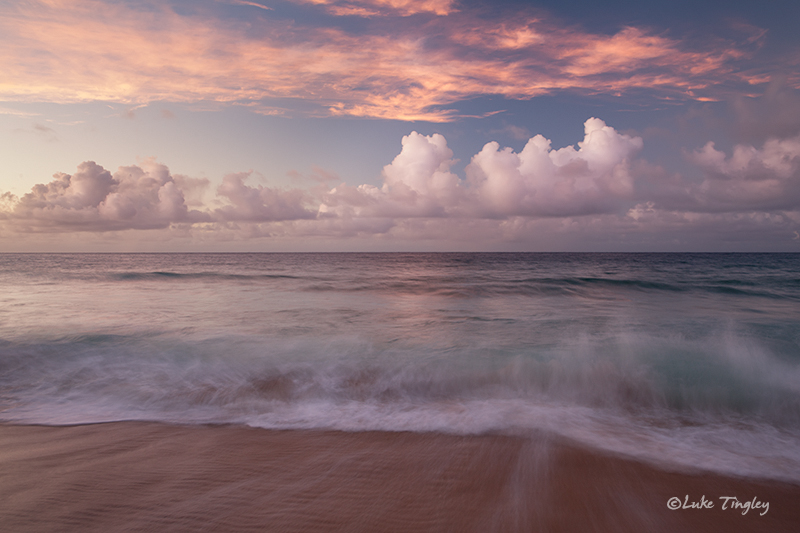 Pounding surf and a passing rainstorm made for a pretty awesome night on Secret Beach in Kauai.