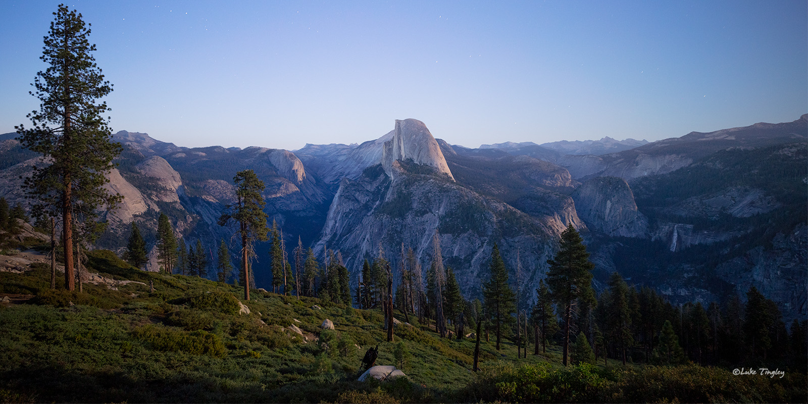 Halfdome in Yosemite, lit from the backside as a full moon rose over the horizon.